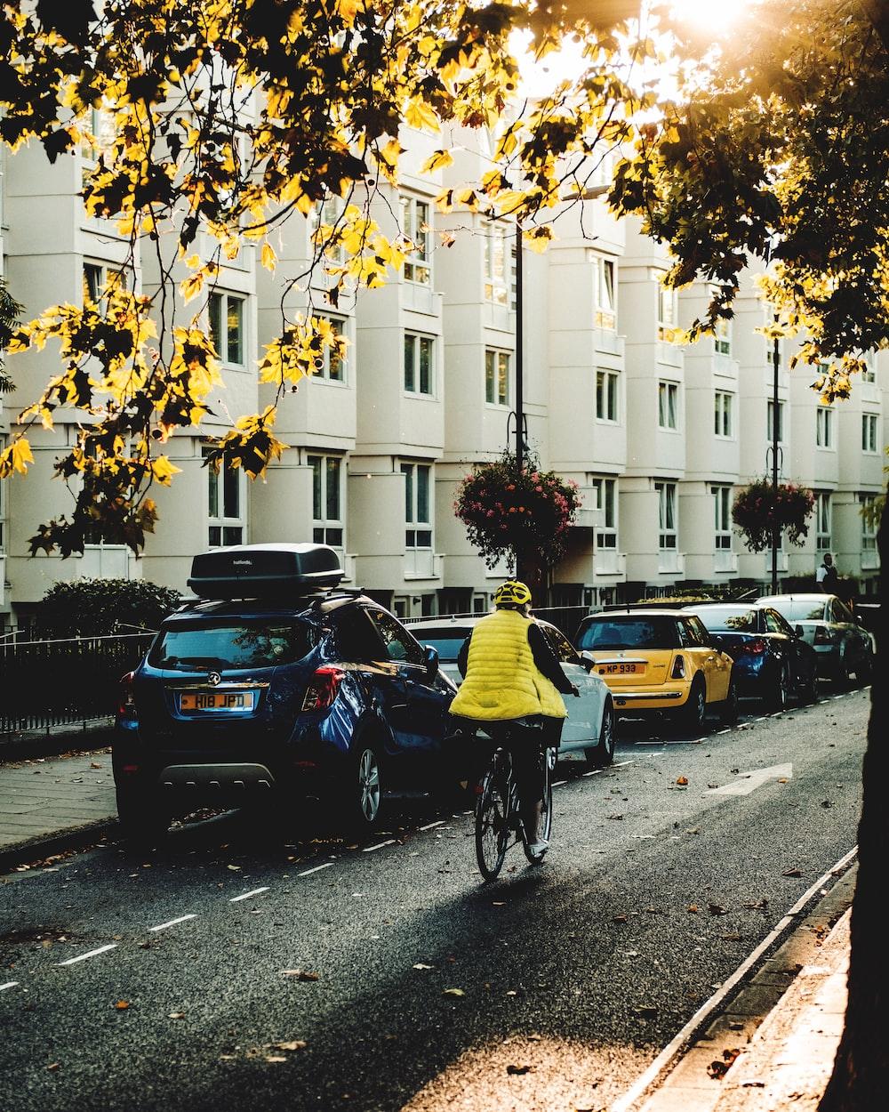 man riding on bike on sidewalkj