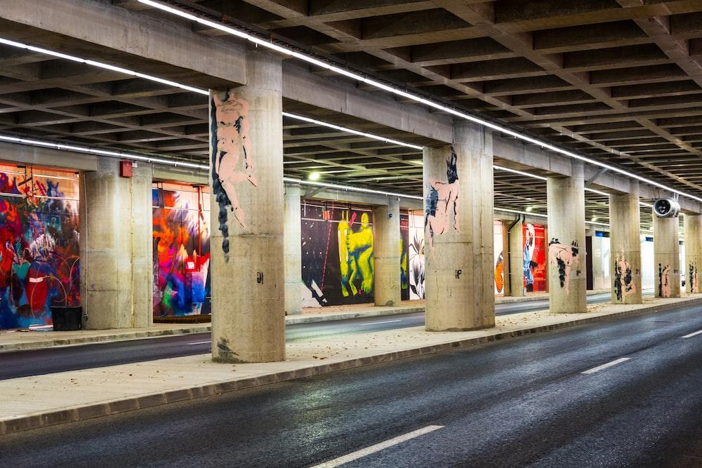 black top road under bridge