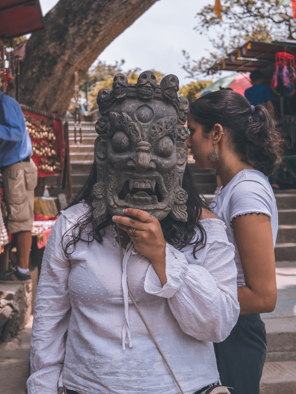 woman wearing a gray monster m ask