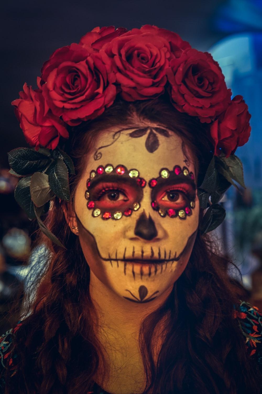 woman wearing skull mask
