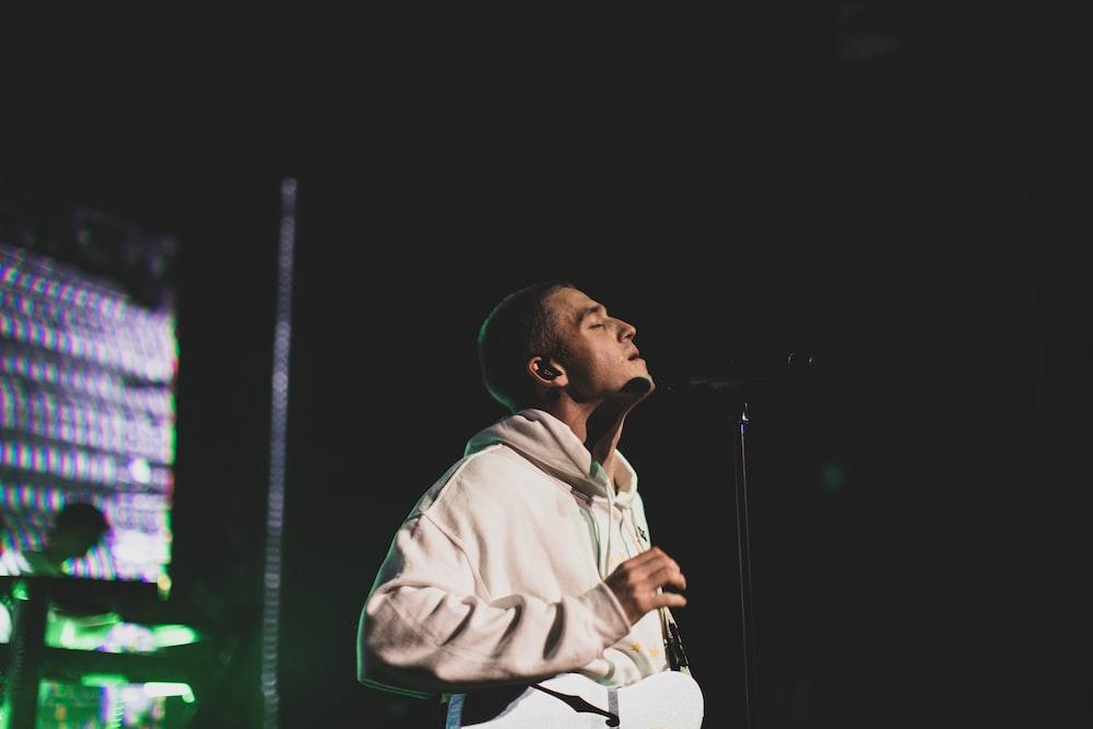 man singing on microphopne