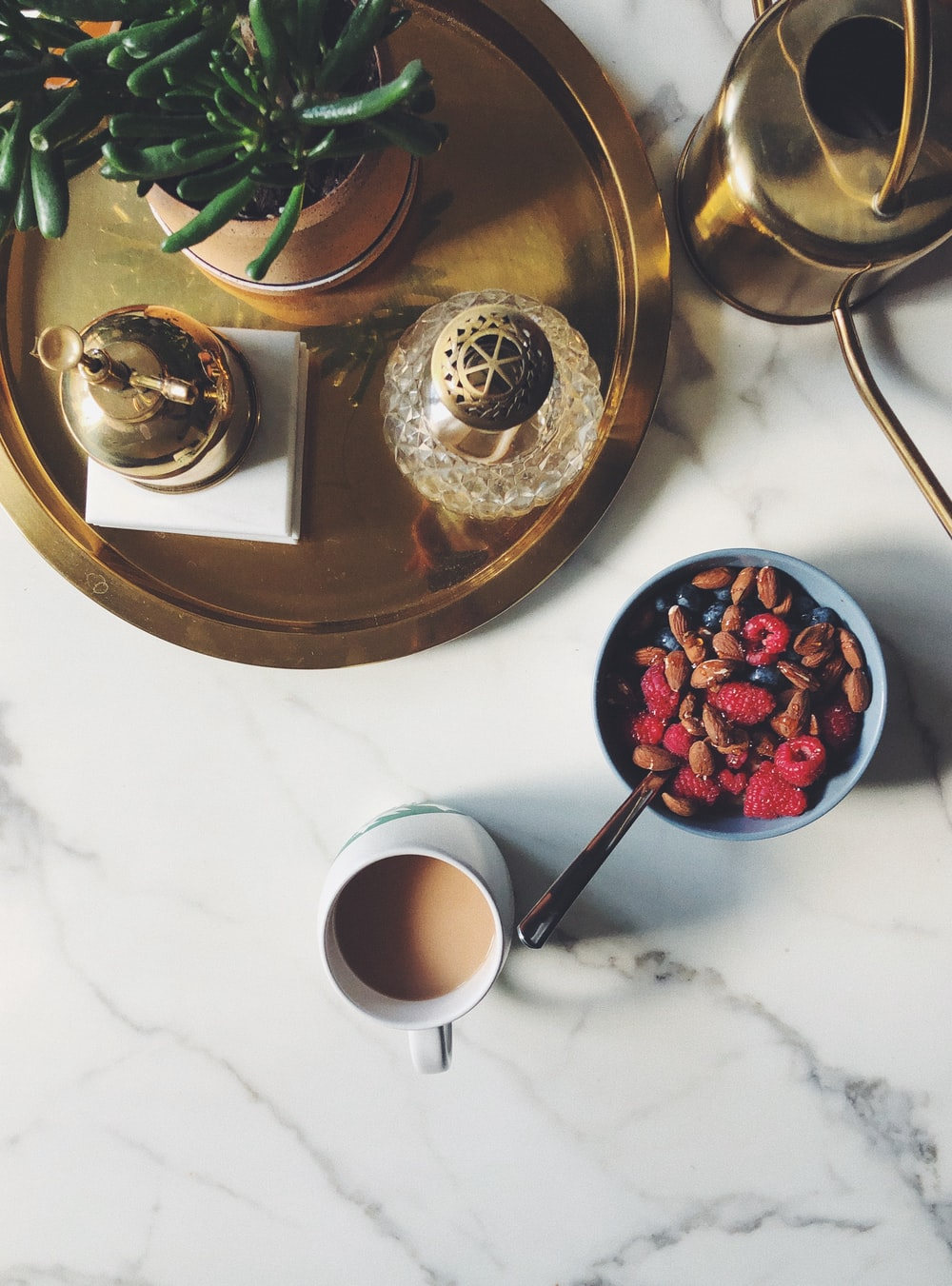 bowl of cereal beside coffee
