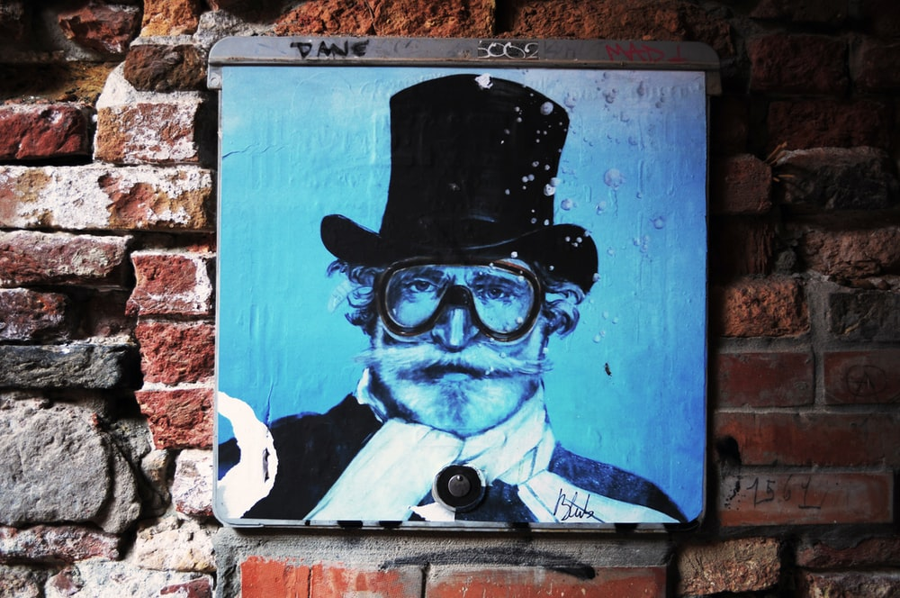 man wearing magician hat painting