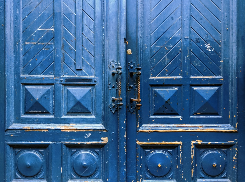 closed blue wooden doors