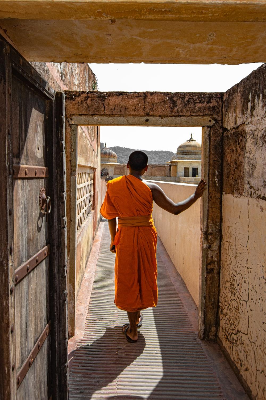 person in orange one-shoulder dress