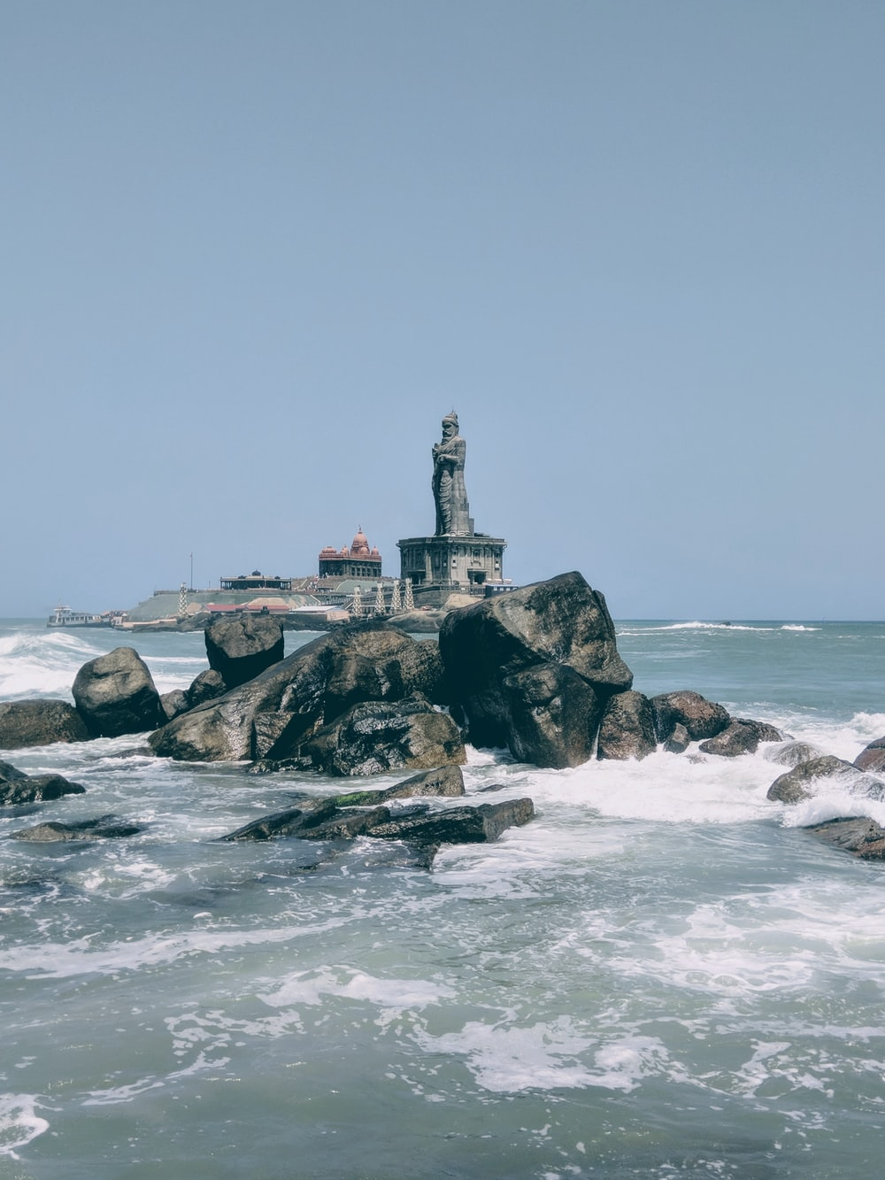 statue near ocean