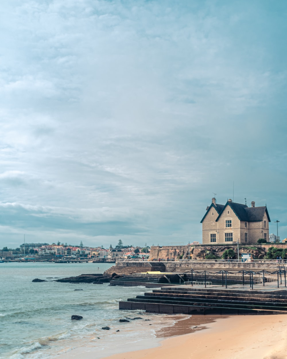 a house by the sea under a calm blue sky