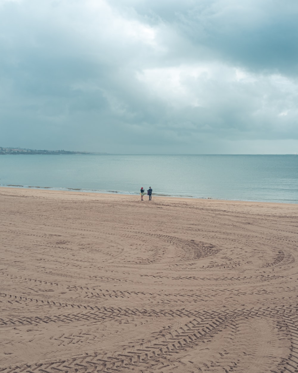 people standing on shore