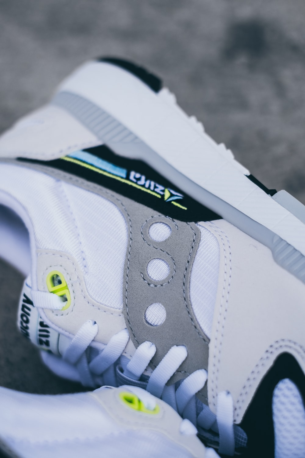 white and gray Saucony sneaker