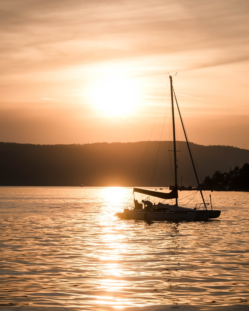 silhouette photography of boat on body of water