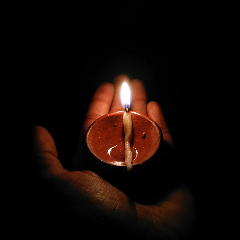 person holding candle