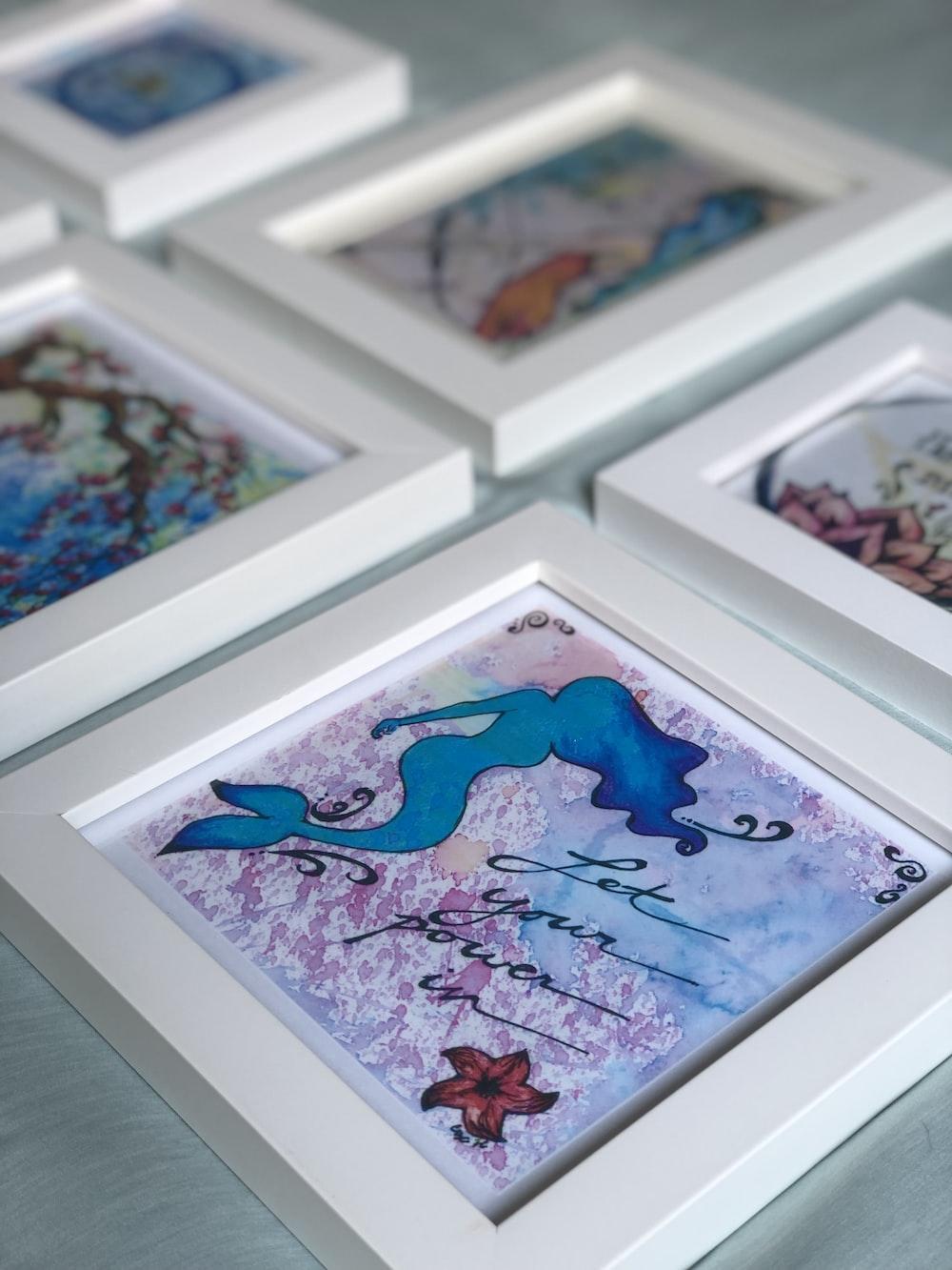 six white wooden photo frames