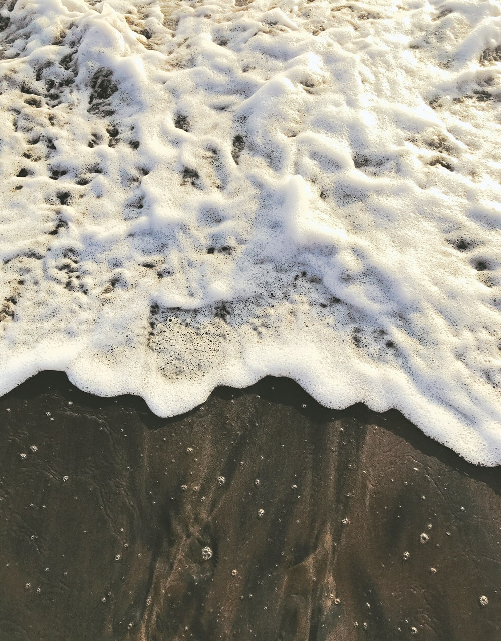 sea bubbles on shore