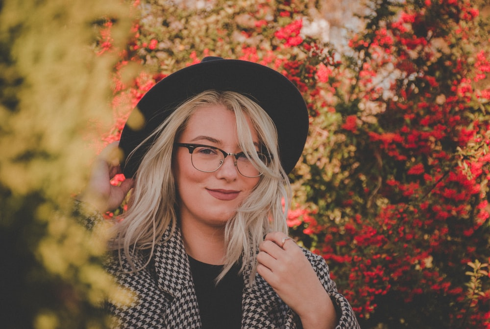 shallow focus photo of woman wearing black wide brim fedora hat