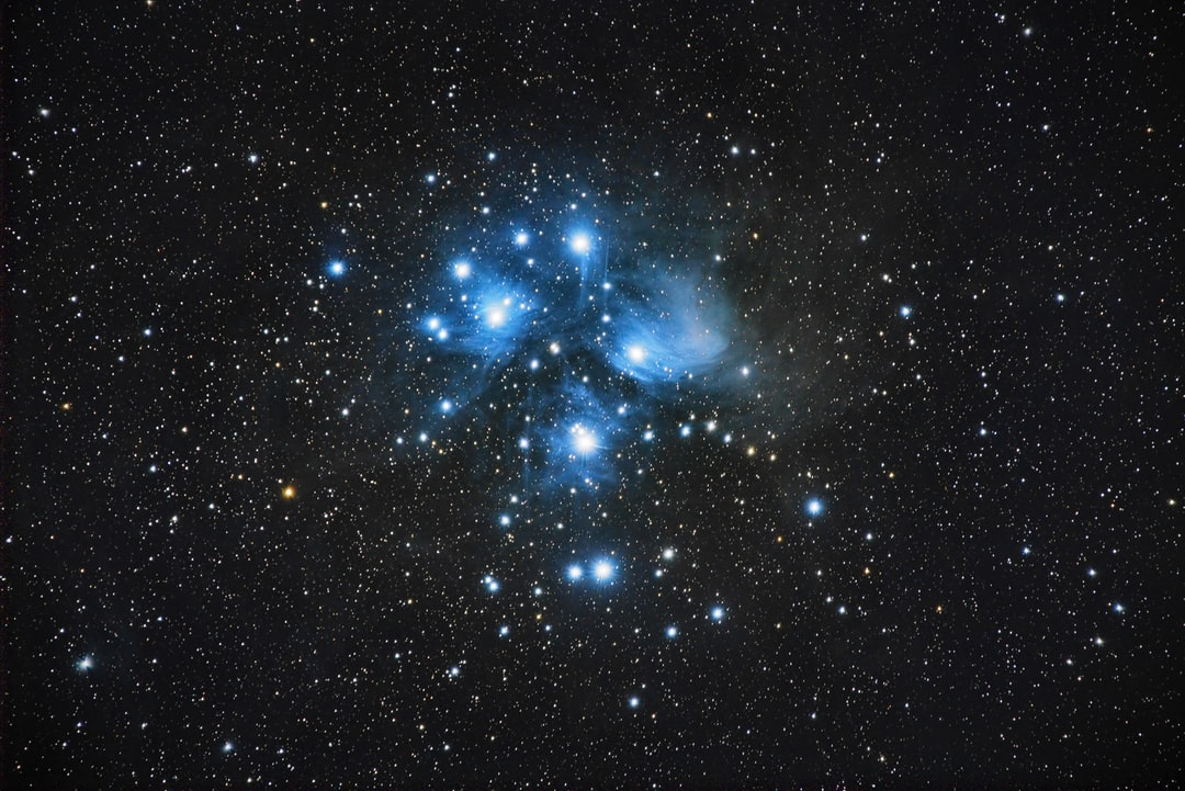 M45 or Pleiades Cluster, group of stars in a blue nebulae