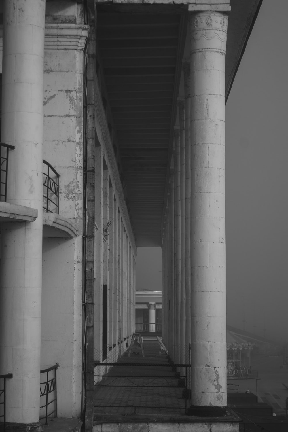 grayscale photo building pillars