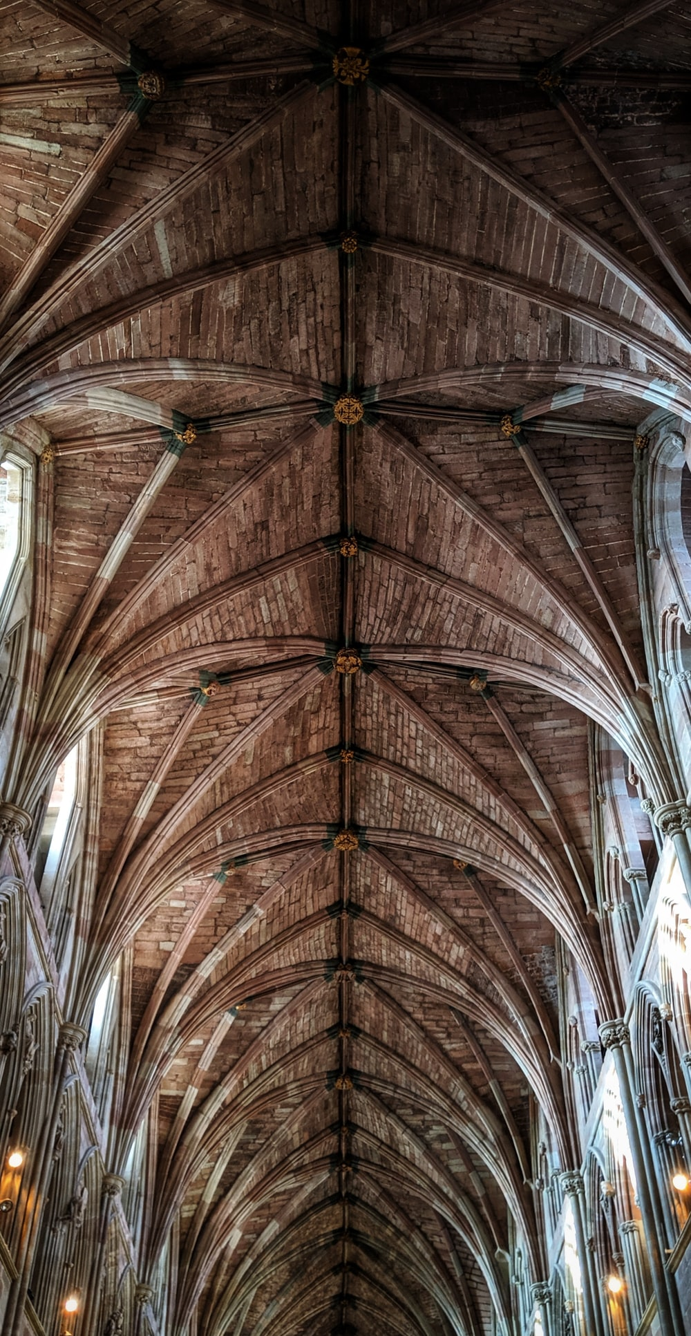 low-angle photogra[hy of brown wooden cathedral roof