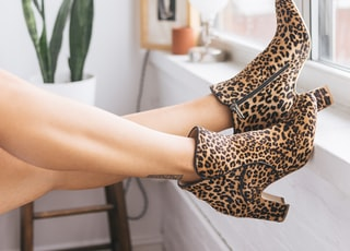 brown-and-black leopard print side-zip booties