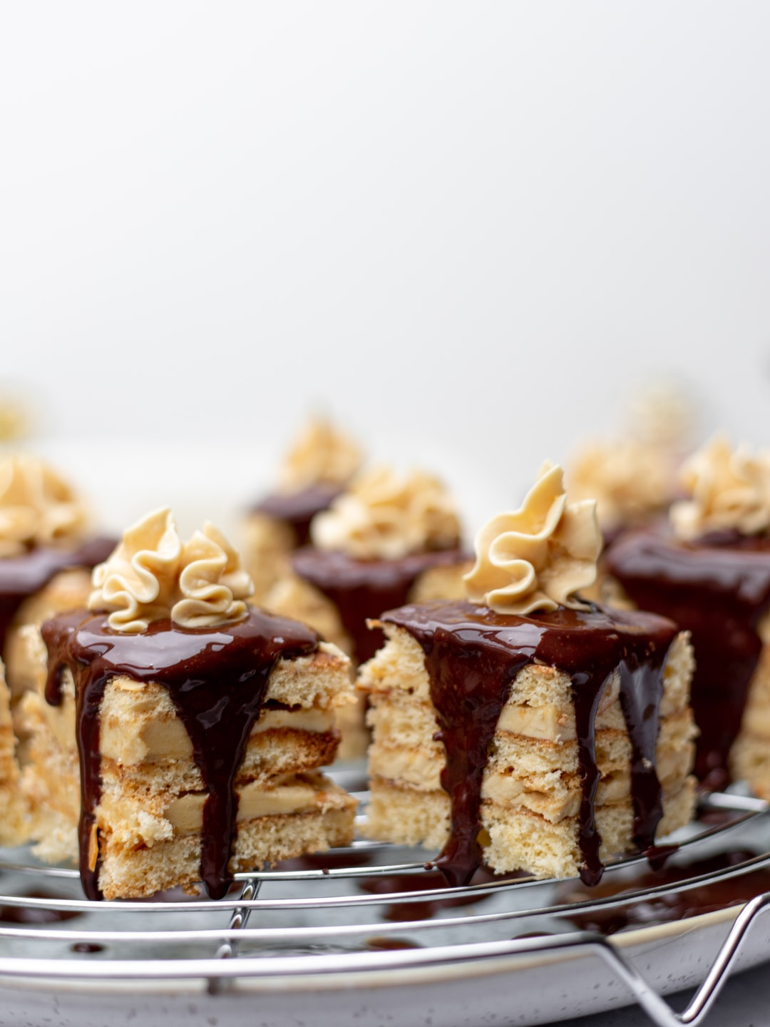 These are delicious petite four made of cinnamon sponge and coffee-infused buttercream.