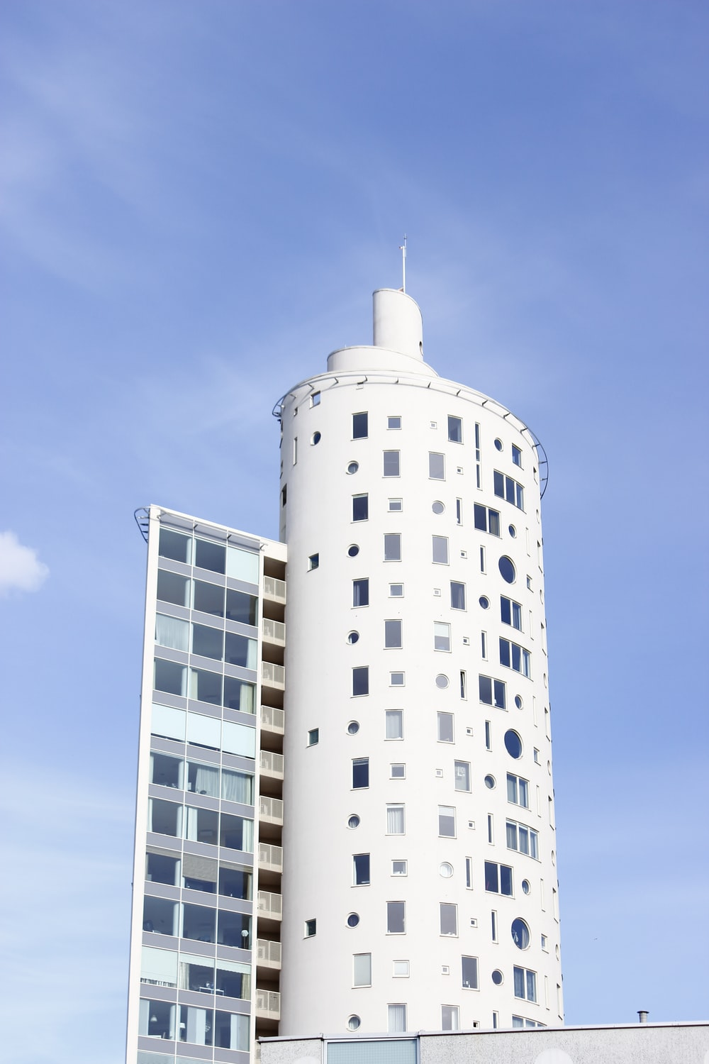 white tower building under blue and white sky during daytime