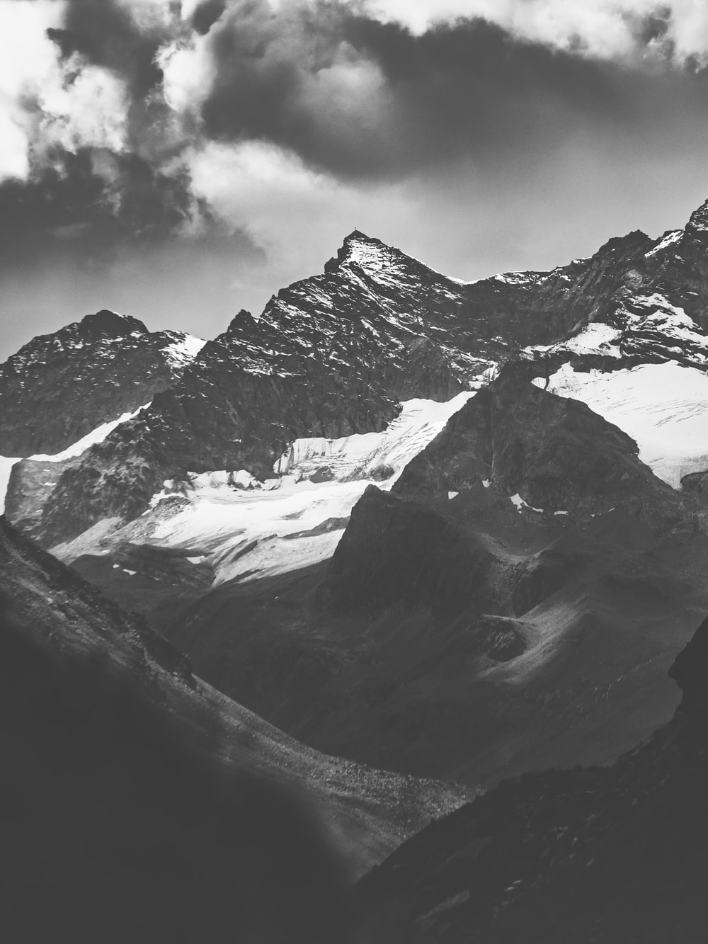 grayscale photography of mountains with snow