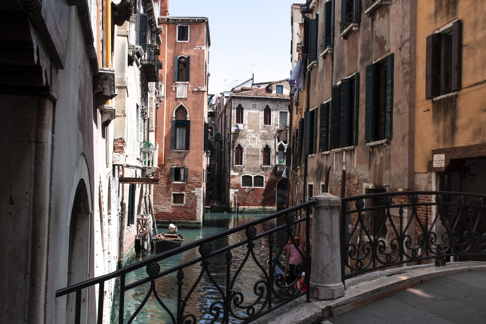 Venice Italy buildings and canal under white and blue sky during daytime