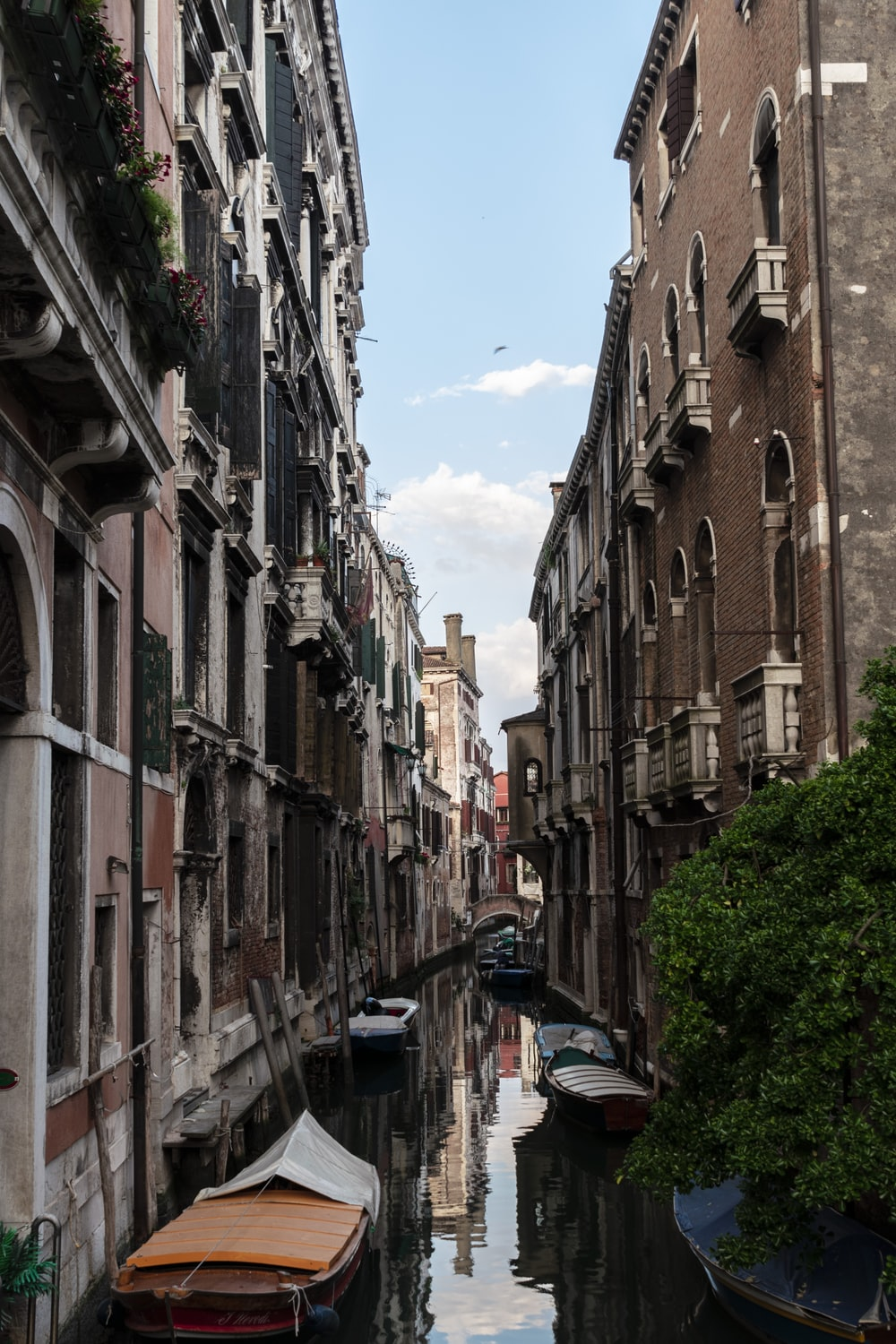Venice Italy canal under blue and white sky during daytime