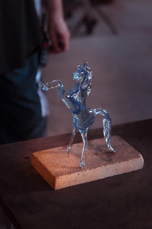blue glass horse figure table decor