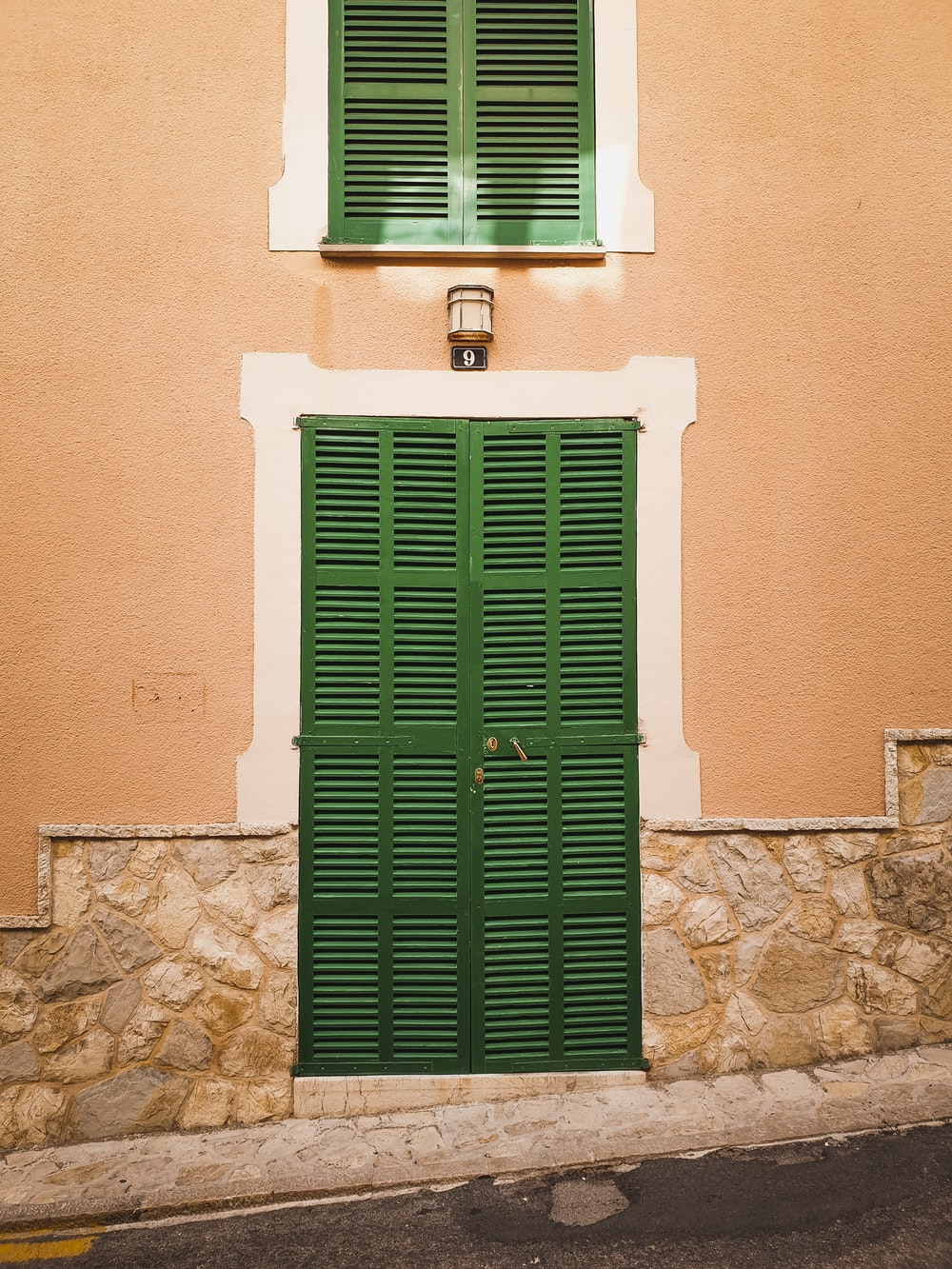 architectural photography of green door