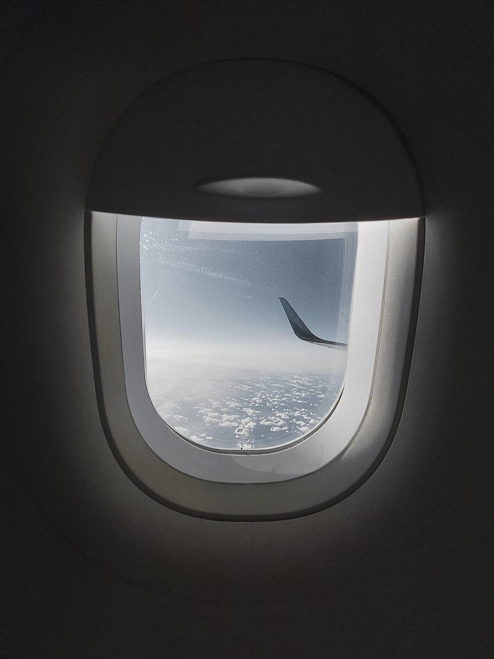 photo of white air plane window