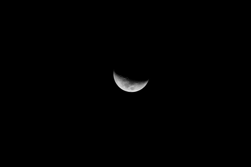grayscale photography of quarter moon