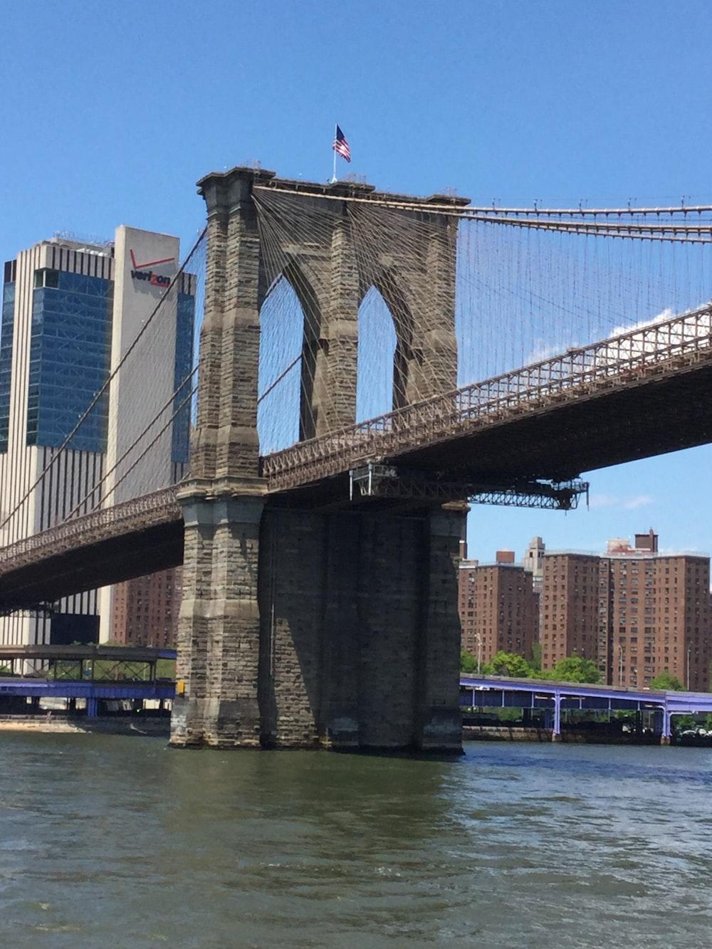 brown concrete Brooklyn bridge
