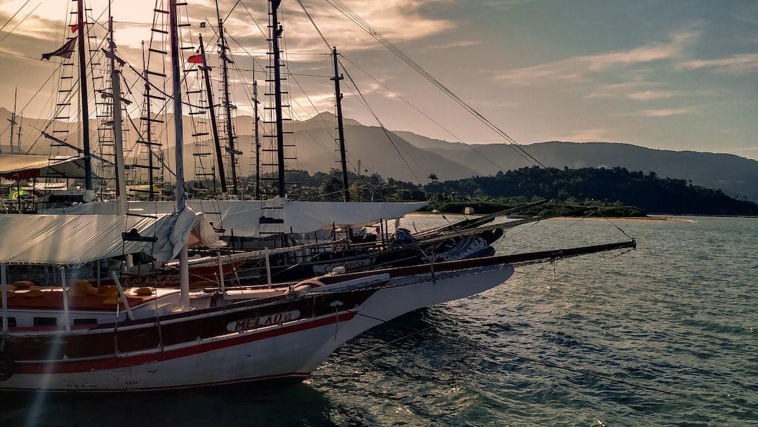 Boats, schooners in the ocean.