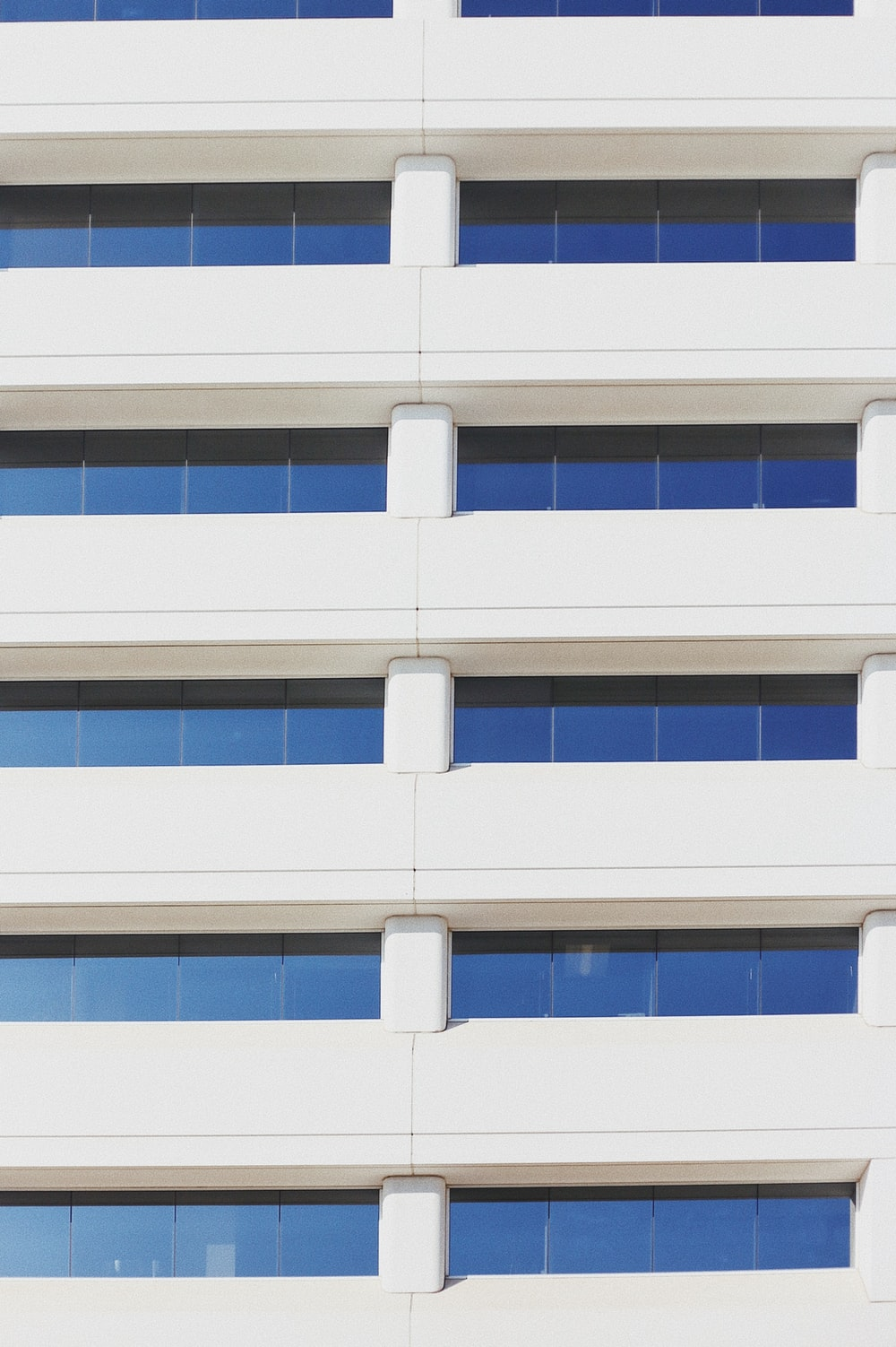 white high rise building with glass window