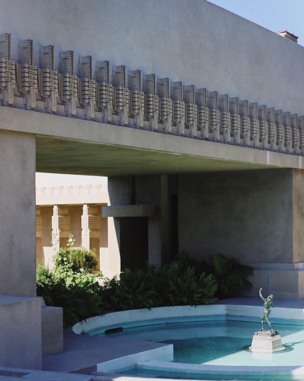photo of white concrete fountain