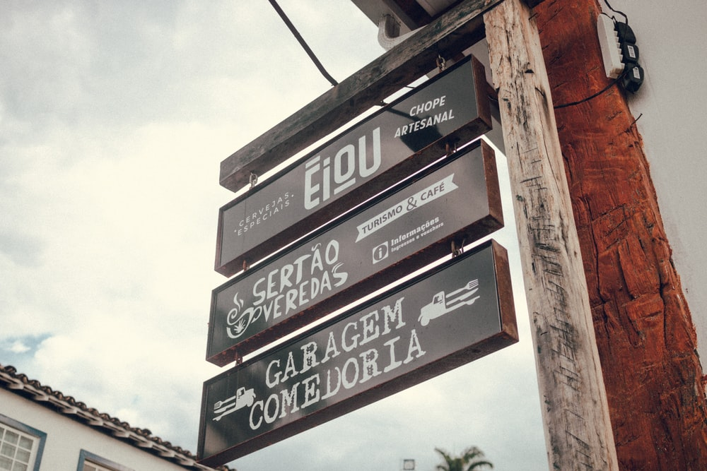 architectural photography of black signages