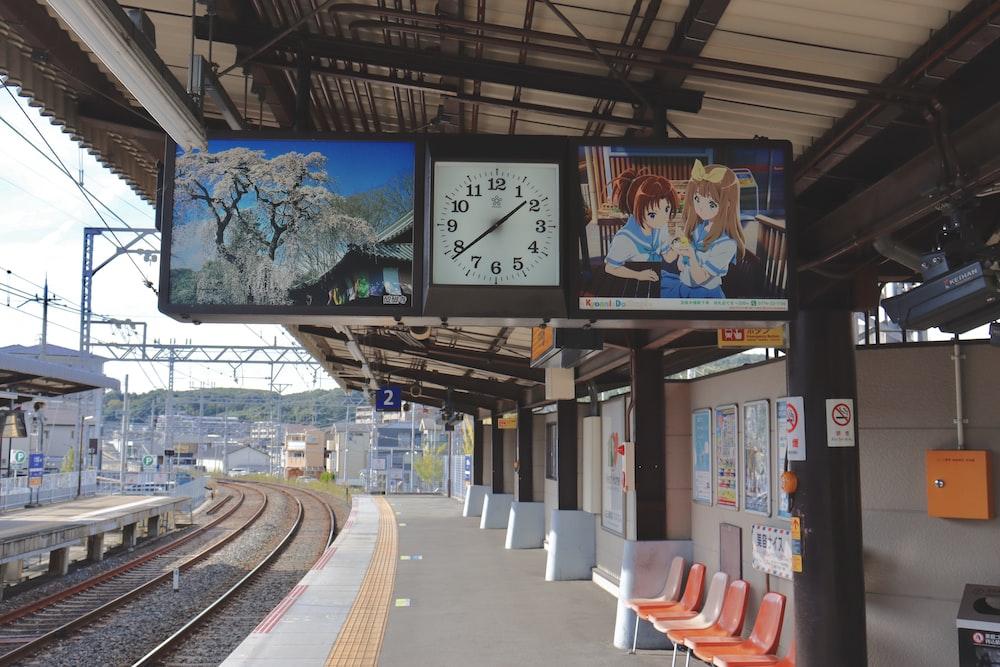 brown clock inside subway