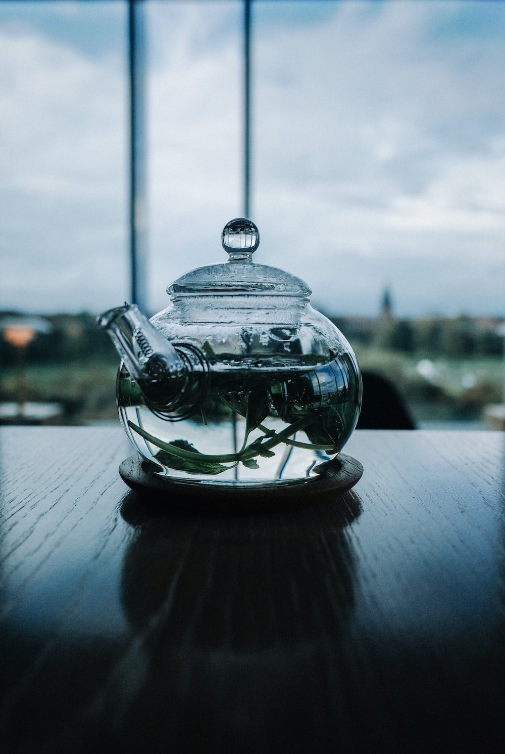 clear glass teapot on table