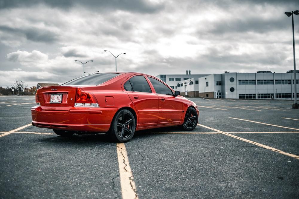 red sedan on parking space
