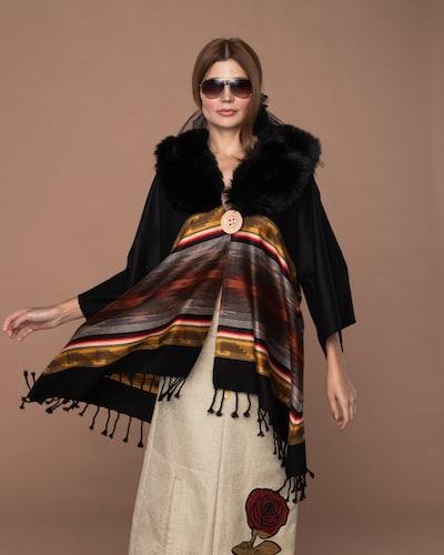 woman wearing black coat and white skirt