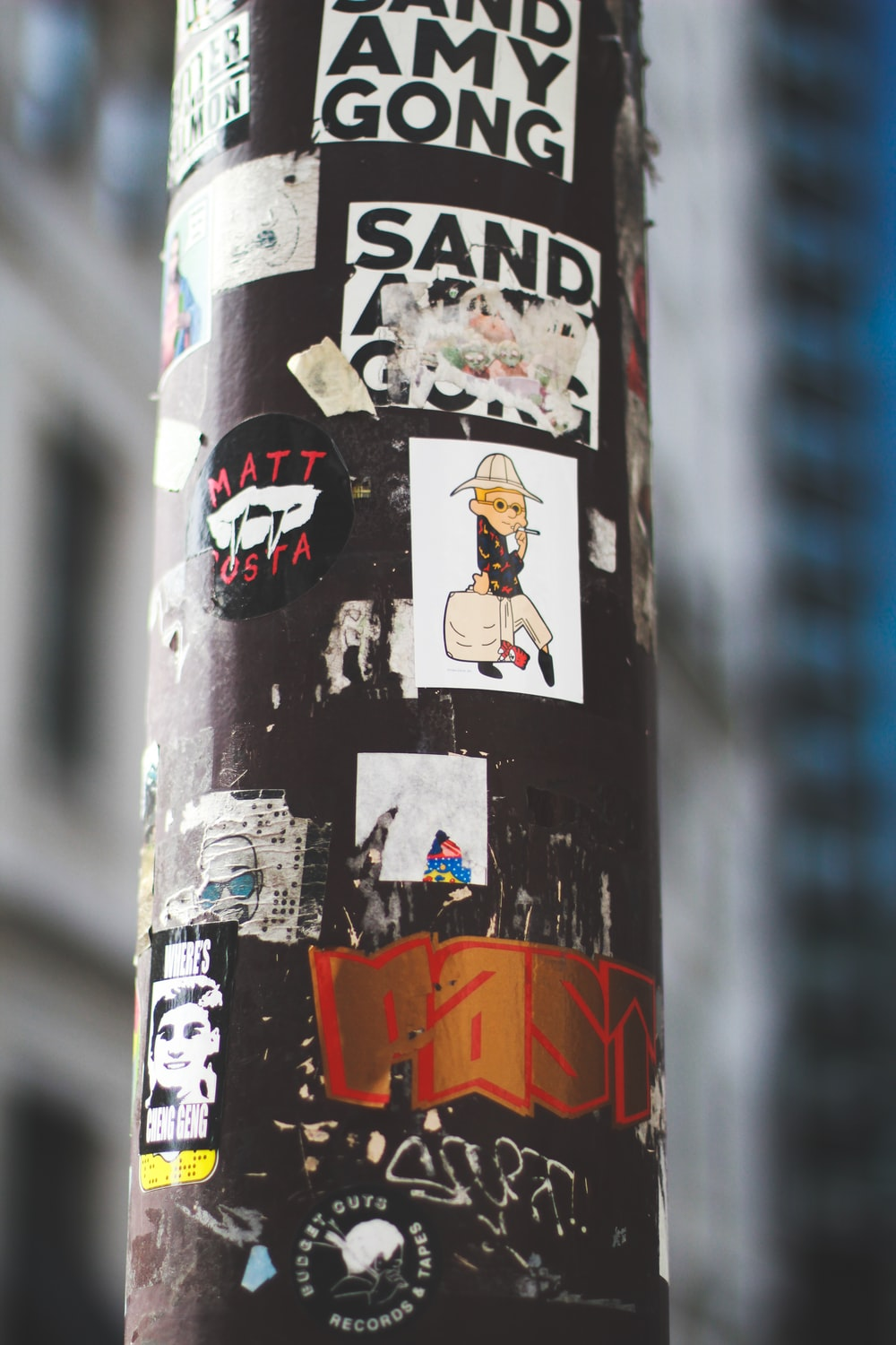 black metal pole with stickers