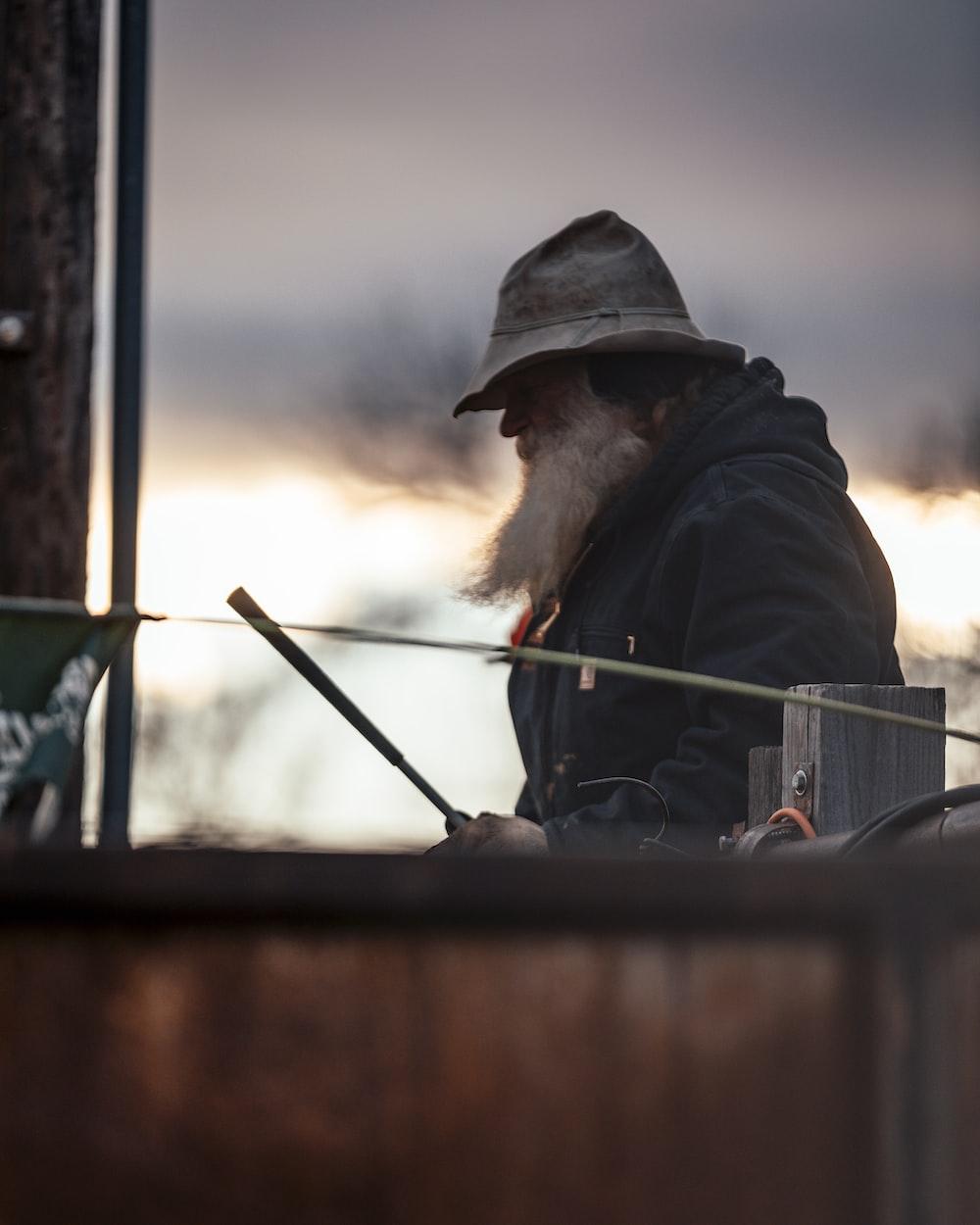 shallow focus photo of man wearing gray bucket