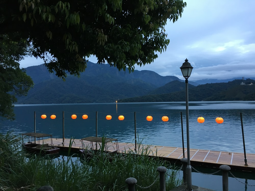 lamp post near body of water