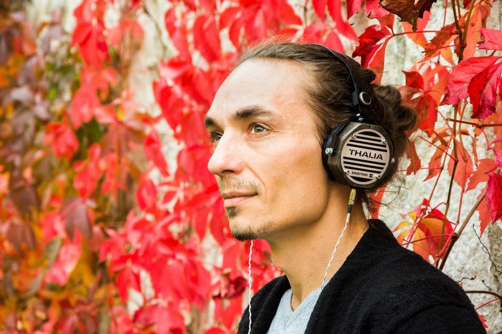 man wearing black and gray headphones
