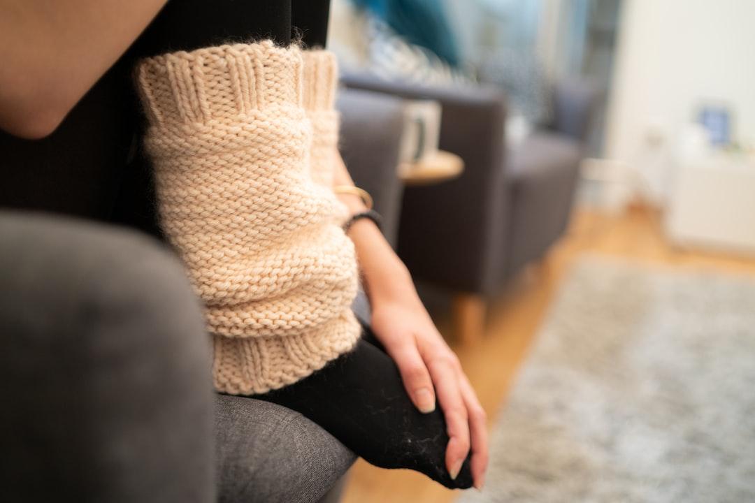 Woman wearing pink leg warmers