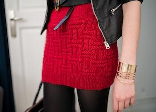 woman wearing red knit miniskirt