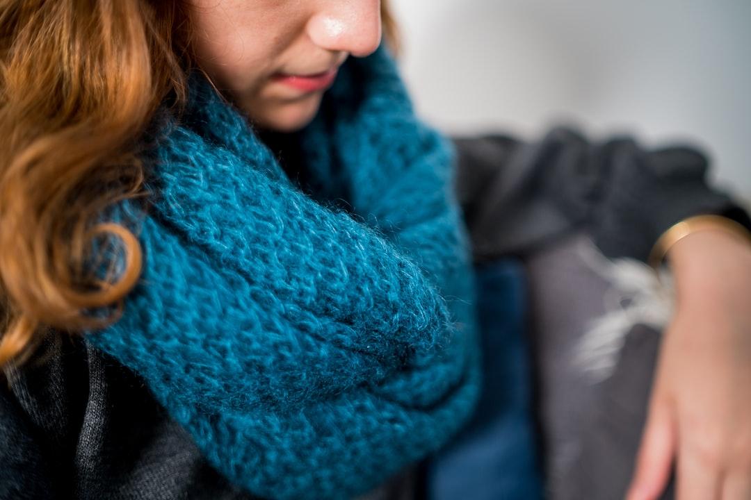 Woman wearing blue handknit scarf