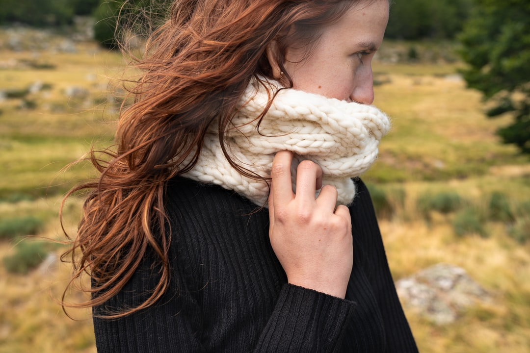 Woman wearing chunky scarf with cables