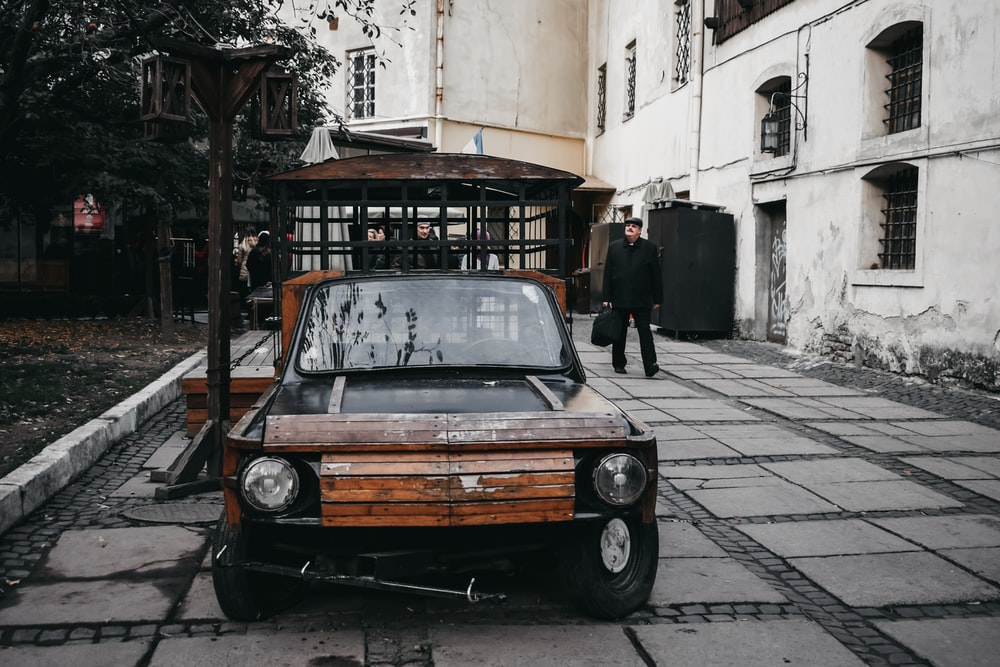 brown vehicle on pavement