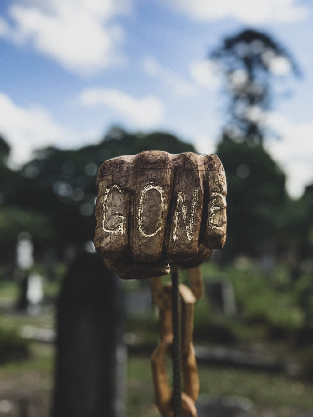 selective focus photo of human fist with gone engrave decor